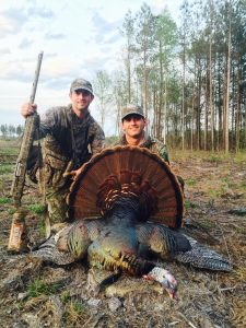Trey and Cody Harrell with a gobbler in Spring 2015